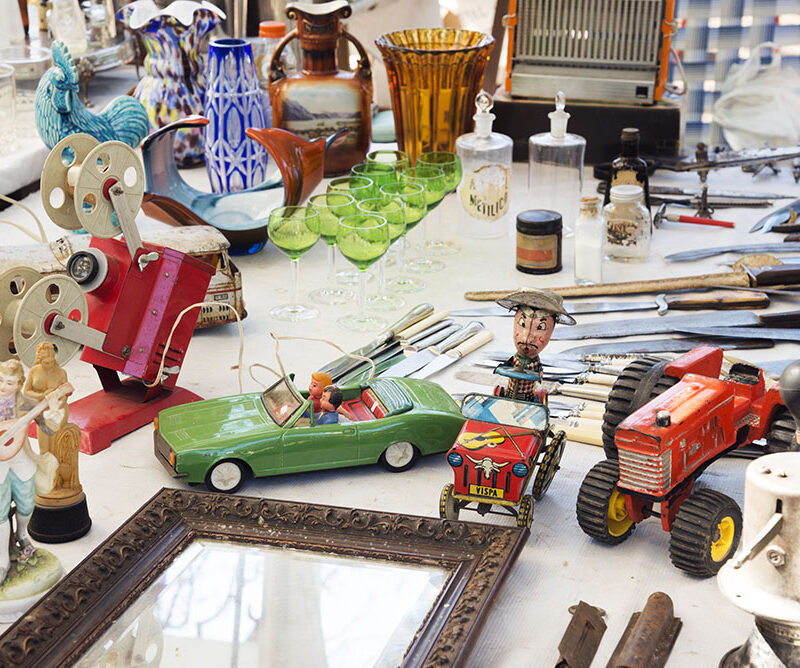 Rosario, Argentina - October 12, 2014: A mixture of antiques from cars to glassware on sale at the Retro Fair
