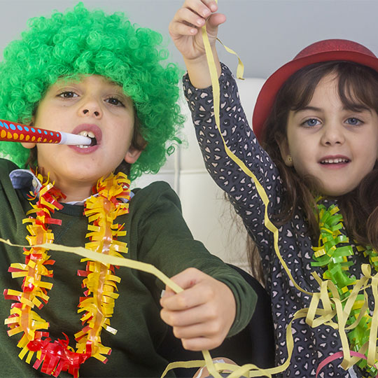 Children celebrating carnival with costumes