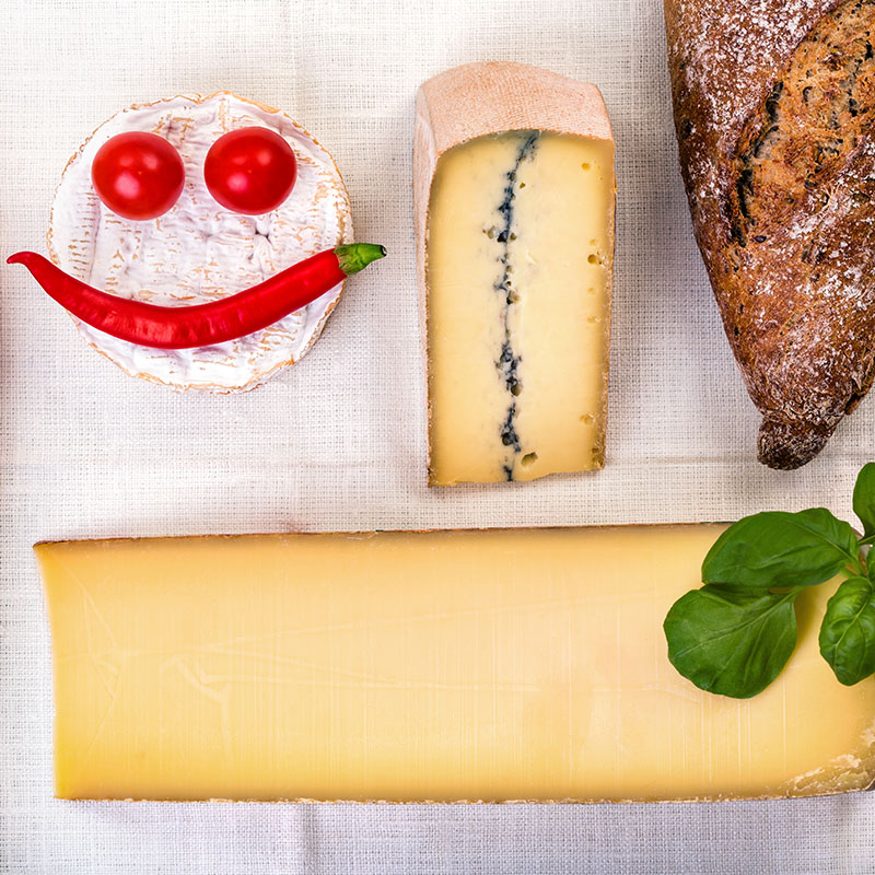 french cheeses - camembert, morbier, comte and baguettes